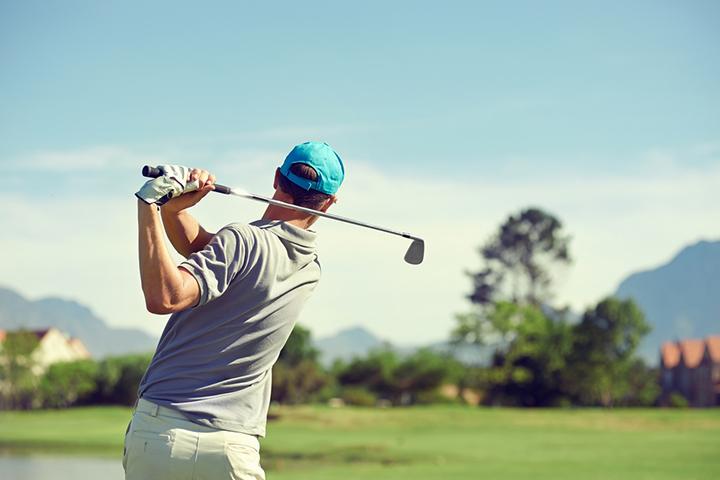 Golfer taking shot