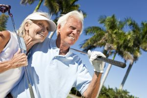 Elderly couple playing golf on Costa del Sol